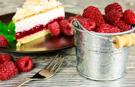 Raspberry cake with meringue top arranged on a wooden table photo