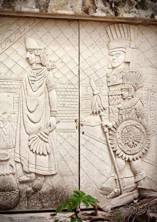 panache: Stone door decorated with ancient mayan sculptures