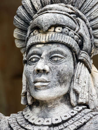 panache: Portrait of stone Mayan warrior on Yucatan Peninsula, Mexico