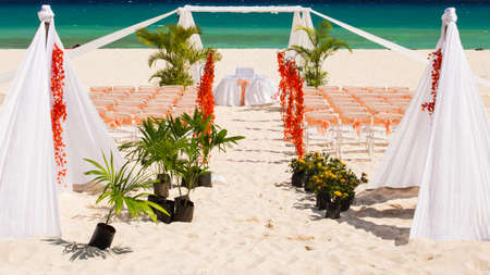 Wedding preparation on Mexican beach against a background of beautiful sea photo