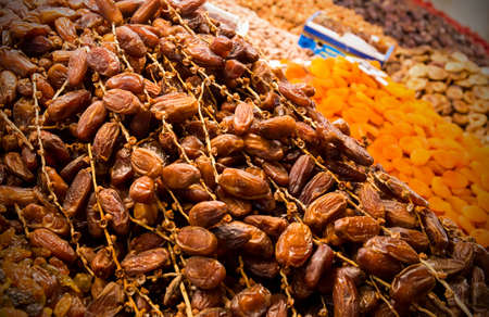 Dried fruits: dates and apricots at moroccan market in Marrakesh photo