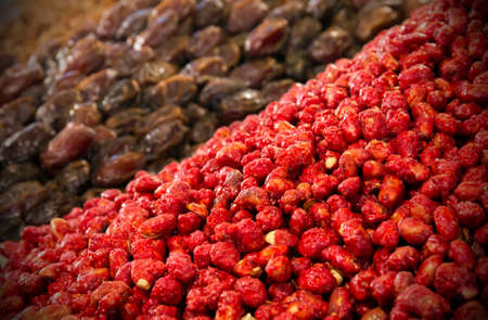 Dried fruits: peanuts and dates at moroccan market in Marrakesh photo
