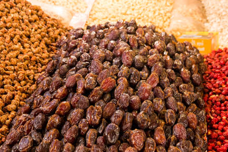 Dried fruits: dates and nuts at moroccan market in Marrakesh photo