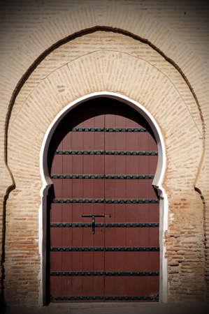 Old arabian door in Marrakesh city, Morocco photo