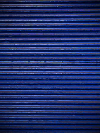 Navy blue corrugated sheet metal for background photo