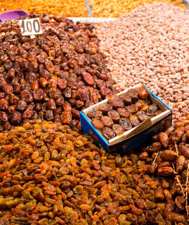 Dried fruits: dates and raisins at moroccan market in Marrakesh photo