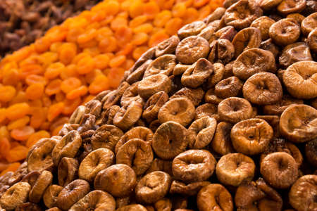 Dried fruits: figs and apricots at moroccan market in Marrakesh photo
