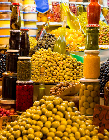 Fresh olives and preserves at moroccan market in Marrakesh photo