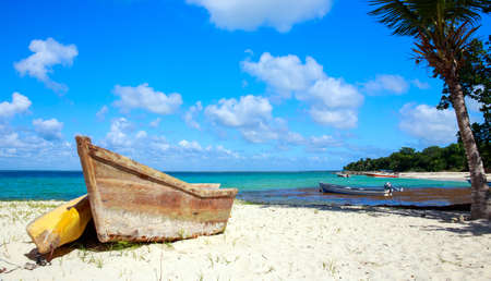 small boat: Small wooden boat on caribbean beach in Dominican Republic