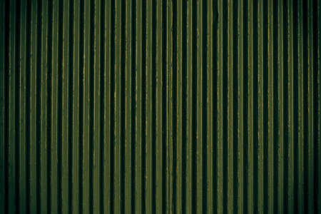 Green corrugated sheet metal for background photo
