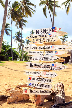 newlyweds: Funny direction signpost with names of newlyweds