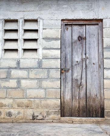 barrack: Old wooden door of haitian refugee barrack in Dominican Republic