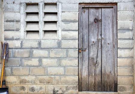 indigence: Old wooden door of haitian refugee barrack in Dominican Republic