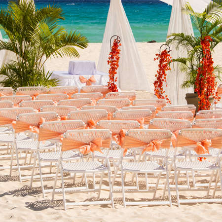 wedding chairs: Wedding preparation on Mexican beach against a background of beautiful sea
