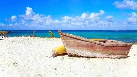 dominican republic: Small wooden boat on caribbean beach in Dominican Republic