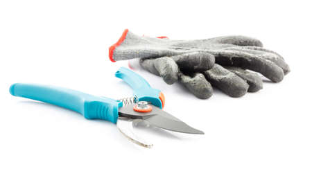 gardening gloves: Pruning shears and worn gardening gloves isolated on white background Stock Photo