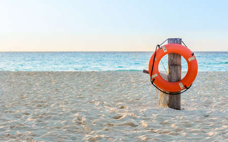 Life preserver on sandy beach somewhere in Mexico