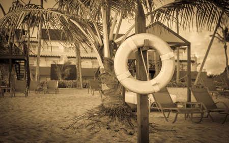 life belt: Retro style photo of life belt on caribbean beach in Dominican Republic