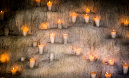 tonnes: Wall full of candles and tonnes of wax Stock Photo