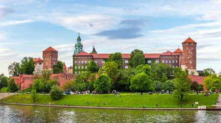 cracow: KRAKOW CRACOW POLAND MAY 09 2015: Panorama of antique royal Wawel castle and the Vistula river in Krakow Cracow Poland