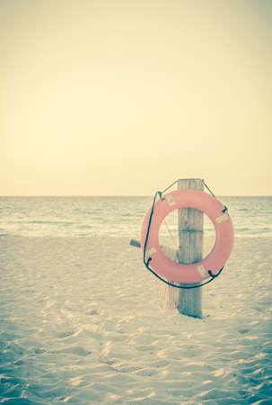 mexico beach: Vintage style photo of life preserver on sandy beach somewhere in Mexico