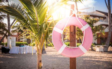 Life belt on caribbean beach in Dominican Republic