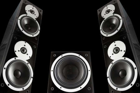 subwoofer: Pair of black music speakers and subwoofer isolated on black background Stock Photo