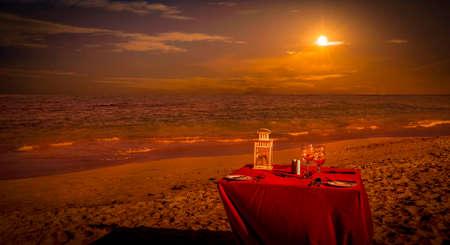 beach landscape: Sunset caribbean beach landscape and party table