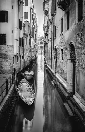 Black nad white canal and gondola in Venice, Italy