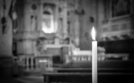 Black and white candle light and altar in the background