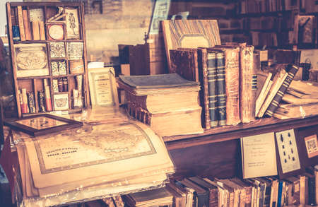 antique books: MONTEPULCIANO, ITALY - JUNE 23, 2015: collection of antique books and maps in tuscan antiquarian bookshop in Montepulciano town, Italy Editorial