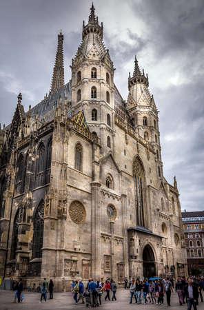 monumental: VIENNA, AUSTRIA - JUNE 19, 2015: Tourists visiting monumental Gothic St. Stephens Stephens Cathedral in Vienna, Austria