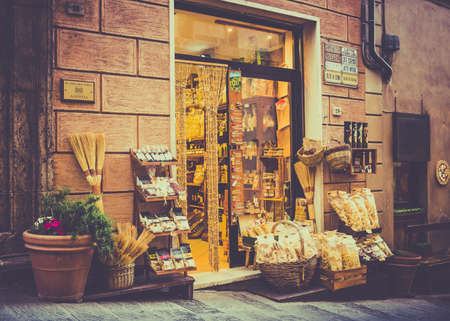 MONTEPULCIANO, ITALY - JUNE 25, 2015: typical tuscan shop with pasta and olive in antique Montepulciano city, Italy