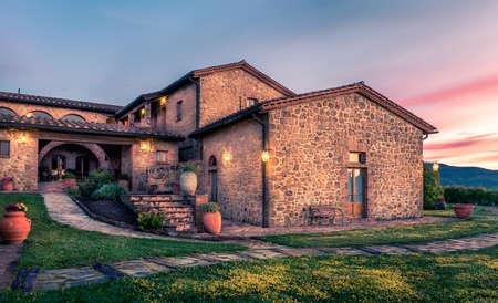 pienza: PIENZA, ITALY - JUNE 21, 2015: beautiful renovated tuscan manor at sundown near historic Pienza town in Italy