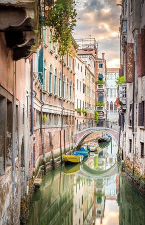 Beautiful narrow canal with silky water in Venice, Italy Standard-Bild