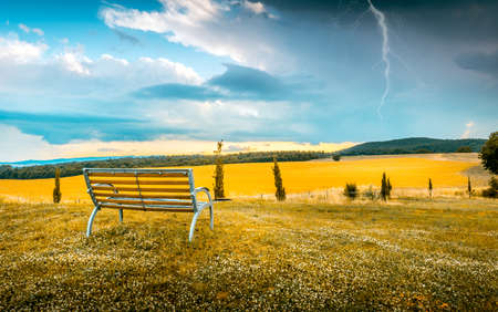 storm: Tranquil scene before a storm with a thunder over horizon Stock Photo