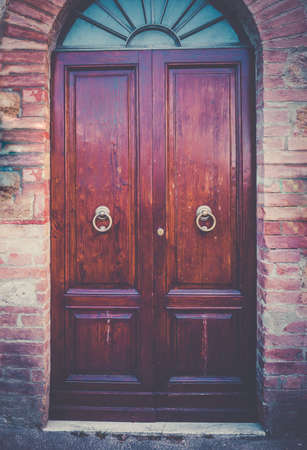 somewhere: Brown vintage door somewhere in Tuscany, Italy