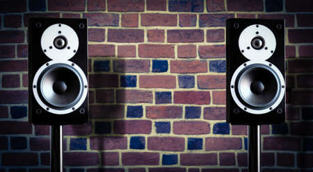 two party system: Black music speakers against brick wall background