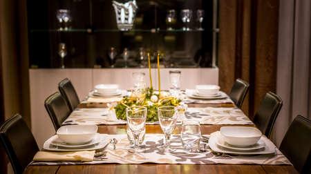gold table cloth: Christmas table setting prepared for festive dinner
