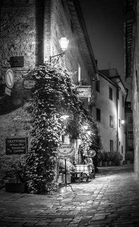 pienza: PIENZA, ITALY - JUNE 27, 2015: Black and white small trattoria in old Pienza town, Tuscany Editorial