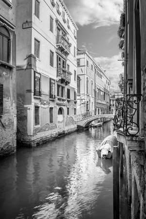 bw: BW narrow canal with silky water in Venice, Italy Stock Photo