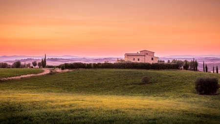 Amazing sunset and farmhouse in Tuscany, Italy