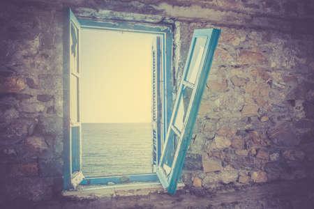 broken hill: Old broken window with view of Aegean Sea