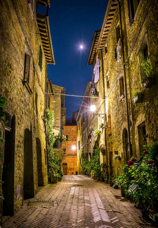 Beautiful street of tuscan Pienza town by night