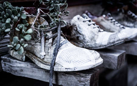 Vintage decoration made of shoe and newspaper in tuscan Montepulciano town, Italy Stock Photo