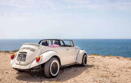 SAGRES, PORTUGAL - AUGUST 26, 2016: Classic cabrio car at Cape St. Vincent in Portugal