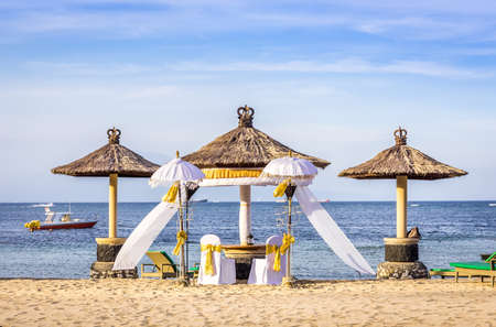Wedding setting on sandy beach in Nusa Dua, Bali