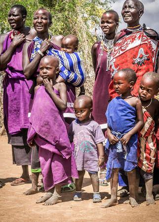 MASAI VILLAGE, KENYA - OCTOBER 11, 2018: Unindentified african people wearing traditional clothes in Masai tribe, Kenya