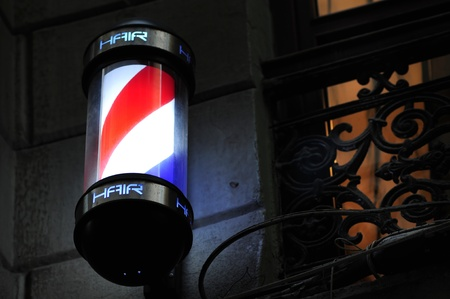 barber pole on the wall, night shot photo