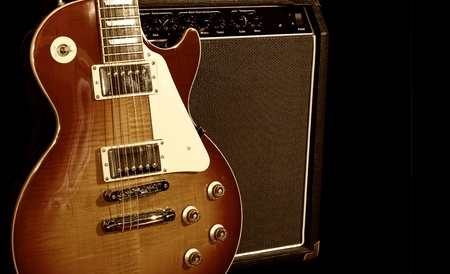 Electric Guitar With Amplifier Isolated on Black Background